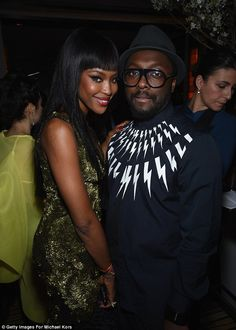 Party time! Naomi cosied up to Black Eyed Peas star will.i.am at the afterparty ...