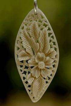 pendant 8 - bone carving by ~manuroartis on deviantART