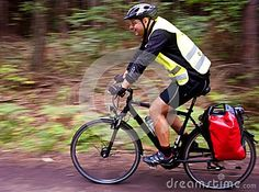 #Trekking #Cyclist #motion blur profile, with travelling #waterproof side #bags.