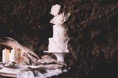 Intricate white wedding cake | Captured By Keryn | see more on: http://burnettsboards.com/2016/02/dramatic-romantic-ocean-cave-ballet/