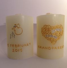 Gift candles for grandparents celebrating twins christening day. Hand engraved and painted with twins names within the filigree heart and christening date with symbol of jug pouring water to represent the occasion. www.candledesigns.ie Twin Names, Hand Engraving, Grandparents, Pillar Candles, Christening, Filigree, Twins, Symbols, Heart