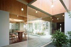 It is an extension of two-story wooden house at residential street in Odawara city. The extended part was planed for cafe and residence. Basic structure is built up with mutually connected ten wooden big-size tables with 42mm-thick flames and...