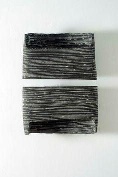 wallpiece%2C+2008%2Cblack+stoneware%2C+porcelain%2C+50x80x10.jpg 1,063×1,600 pixels