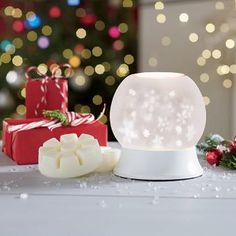 No need to shake this snowglobe! Simply turn on our electric Warmer to make the snowflakes swirl and release your favorite fragrance. 'Tis the season for shopping at PartyLite.