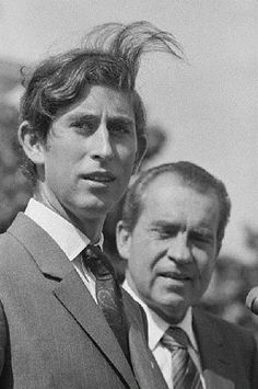 Washington, DC: Prince Charles hair blowing in the wind is welcomed to the U.S. by President Richard Nixon on 16 July 1970