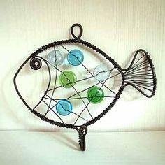 artigos feitos de fio-governanta peixes