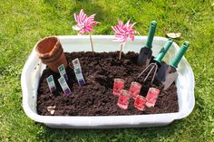 Gardening Sensory Bin - really cute .... would exchange the 'real' tools for safer plastic ones.  Love the pinwheel flower idea - more than a 'tactile' based tub - Awesome!