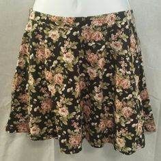 Forever 21 Medium Floral Skater Mini Skirt This is a pretty mini skirt from Forever 21 that is skater style, and is dark blue with pink flowers that have green leaves.  This is flowy and size medium.  #skaterskirt #miniskirt #floral #flowy #skirt #forever21 #medium Forever 21 Skirts Circle & Skater