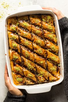 This vegan date baklava is a healthier take on this classic Middle-Eastern dessert. It's filled an aromatic date and nut mixture and glazed with homemade date syrup instead of sugar syrup. It's easy to make, delicious and makes a great tea or coffee companion.