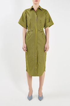 The Tiller Shirtdress is cut in an of-the-moment oversized fit, featuring adjustable side panels to cinch the waist. Balancing the silhouette with broad t-shirt sleeves, this vivid yellow and black striped cotton dress is punctuated by mother of pearl detail buttons.