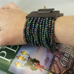 """{HP} GWaC Java Bead Cuff Bracelet - Iridescent Host Pick 12/13/15  THIS LISTING MAY BE PURCHASED!   Stretchy to fit most wrist sizes. This is a Balinese artisans only means of income to support her family. Purchasing Lara's necklaces enables her to continue home based work so she can take care of her young children.     Color: Iridescent     Size: 7 1/2 to 9""""L x 2""""W x 1/2""""H     Material: Glass Beads, Mango wood     Region: Indonesia, Fair Trade Gifts with a Cause  Jewelry Bracelets"""