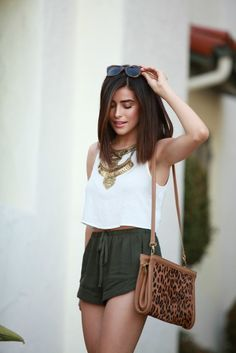 spring / summer - street chic style - beach style - party style - summer outfit ideas - leopard print shoulder bag + olive green drawstring shorts + white sleeveless top + golden statement necklace + leopard print sunglasses + brown ankle strap tassel heeled sandals