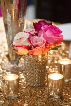 Hot pink, navy, and gold glitter wedding centerpiece