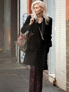 Straight line coat, oriental print on pants and purse, vertical jewelry