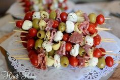 italian appetizers ital sausage. salami. baby bell. tom. olives. artichoke hearts. marinate in ital dress
