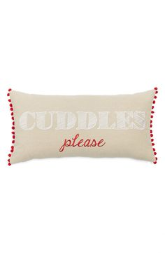 Tiny, red pompoms trim this irresistible accent pillow embroidered with a charming call for affection.