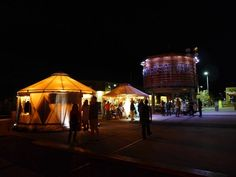 """In the Santa Fe Railyard: The cross-country art train event """"Station to Station"""" set up yurts for designers to showcase their latest work while the party continued inside the nearby Farmers Market building. (Photo by Glamour Magazine)"""