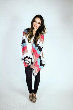Gloss Boutique - Teal/Coral/Black Zigzag Sweater, $45.99 (http://www.glossboutique.com/just-in/teal-coral-black-zigzag-sweater/)