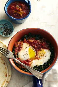 Top garlicky spinach with salsa-poached eggs for a fast and flavorful lunch.