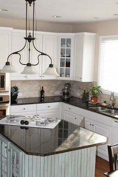 White cabinets, dark countertops... I would change the backsplash to grey/marble look