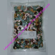 Chocolate River Stones are candy coated chocolate that look like little rocks that should be at the bottom of your fish tank, not on your cake. Chocolate Rocks, Dino Cake, River Stones, Chocolate Coating, Honeycomb, Wedding Chocolates, Cake Decorating, Candy, Birthday Ideas