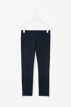 Slim-fit trousers with ankle zip