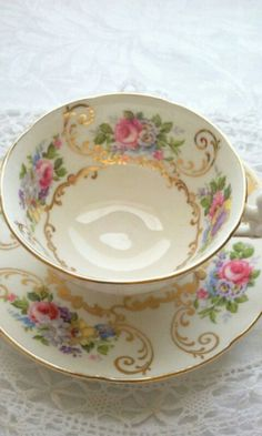 Afrancesada. Reminds me of Grandma Jane Hill.  Cups and  saucers like this were what she used EVERY DAY!