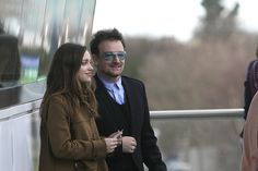 Bono from U2 with his daughter Jordan Hewson look at the races from the Leopardstown Pavillion on St. Stephen's Day during the Leoparstown Christmas Festival. Picture Colm Mahady / Fennells