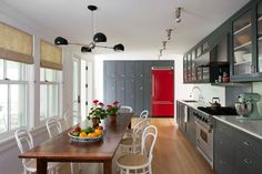A fabulous red fridge pops against the gray cabinets in this cool kitchen. - Traditional Home ®/ Photo: Rebecca McAlpin / Design: Katie Lydon