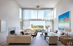 One of the homeowner's favorite objects in this Thad Hayes–designed beach house in Water Mill, New York, is a Sputnik chandelier—a relative of the ones at Manhattan's Metropolitan Opera House—which brings drama to the double-height living room.