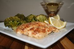Slow Cooker Lemon Chicken with Broccoli | The Magical Slow Cooker.  Zesty Italian dressing mix, flour, chicken, lemon, oil. Shake dry ingredients and chicken in ziplock bag, brown in pan, put lemon juice in bottom of crock pot, add chicken. Cook 2 hrs on high, then add broccoli on top for another hour.