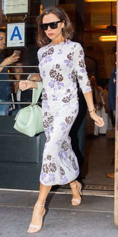 After a streak of slouchy, menswear looks, Victoria Beckham did a 180 and selected pretty pastel floral-embroidered separates (no doubt one of her own), complete with a seafoam green Victoria Beckham bucket purse and neutral sandals.