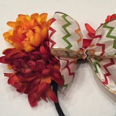 Pictured is a handmade, set of floral Minnie ears.  Flowers in front of ears only due to weight.  All of our products are handmade and one-of-a-kind. No two of our products are the same, although they may have similarities. If you have any questions, please feel free to send us a message. We respond as quickly as possible.  DISCLAIMER: Headband fits both adult and childrens heads, however, it does not fit a toddler. Handle with care. Do not put the Minnie Ears in the wash  All sales will be…