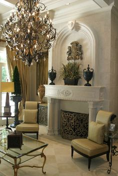 Beautiful carved mantle, lovely chandelier - living room with fireplace, neutral colors