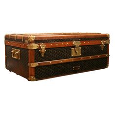 vintage Goyard trunks. expensive, but so much character.