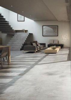 Šedá podlahová stěrka Microtopping na podlaze v obývacím pokoji. / Grey floor coating Microtopping on the living room floor, BOCA Praha. http://www.bocapraha.cz/cs/produkt/646/microtopping-podlahova-designova-sterka/
