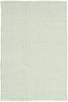Test drive this rug in your space.Order a swatch by adding it to your cart.Bunny Williams fell in love with this subtle diamond pattern in an easy-care cotton weave, part of her collection for Dash & Albert. This area rug, in a soft green hue, is at home almost anywhere, from cozy guest rooms to sophisticated offices.