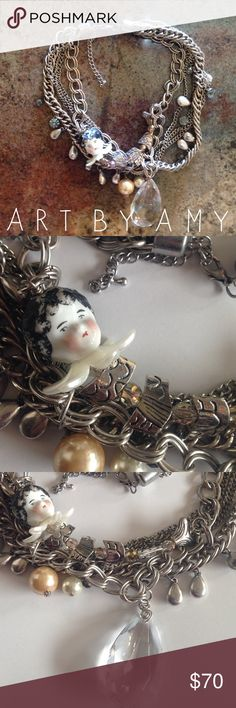 Art by Amy Chunky Dresden Doll Necklace Selling this unique necklace, which apparently the porcelain doll head is actually a Dresden doll which were made in the 1800s in Germany and were found under the destroyed factory that made them. I cannot verify if this is true but still looks really cool and unique. The necklace is made of crystals, acrylic, metal and porcelain. Art by Amy Jewelry Necklaces