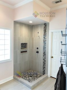 We installed 12x24 porcelain tile with glass tile as a desaing and pebble rocks for shower floor. #ideashome #bathroomideas #cornershower #lightcolortile #bathroomwithlightcolor #lightcolorbathroom