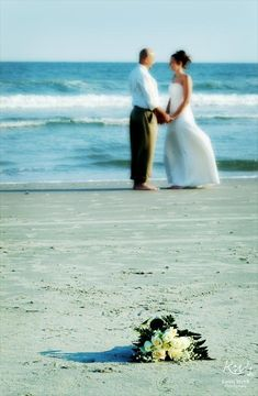 Beach Wedding....have girls sitting by flowers maybe???