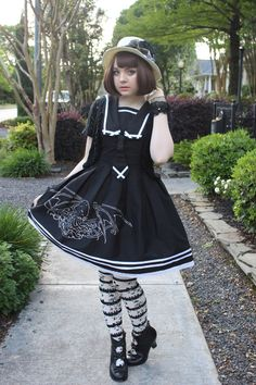 Tumblr user misslillith with striped socks in the Nightmare Rising JSK.