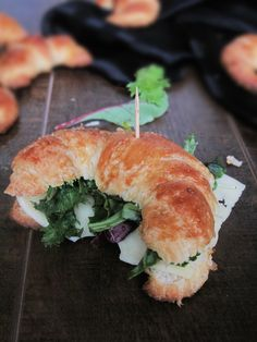 Fresh, home-made butter croissant sandwich with spring mix and rycki edam cheese