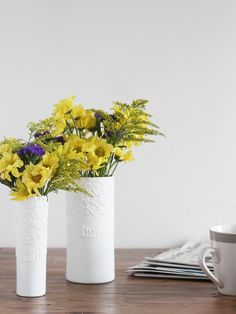 Skip the pricey porcelain vases and make your own textured showpiece with a basic glass hurricane vase, a piece of lace and some white acrylic paint.