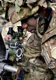 A soldier from 1 Royal Anglian Regiment aims a mortar during training at the Stanford Training Area (STANTA) in Norfolk