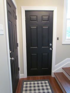 Beautiful! I love the black doors with white trim and wood floors. It's a fresh, modern take on traditional styling and the floors keep it feeling warm and not too stark. Perfection.