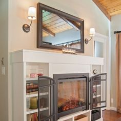 Hidden TV Over Fireplace | Seura television mirror over fireplace ...