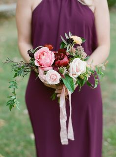 A lush pink rose is the focal point of this bridesmaid nosegay by Springvine Design.