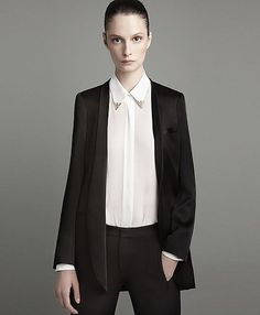 Suzie Bird for #Zara August 2011 Lookbook in satin blazer, button-down blouse with metal collar tips, and black trousers.