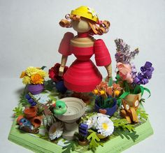 three dimensional woman in garden, paper quilling