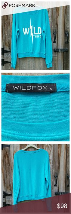 """Wildfox Wild Thing Baggy Beach Jumper Super soft and cozy bright blue BBJ with white print. Relaxed fit, extra long sleeves, ribbed trim at cuffs and bottom. Length 23"""" from back of neck, width at bust 21"""", sleeve length 28"""" from shoulder. Poly/rayon/spandex, machine wash/dry. Wildfox Tops Sweatshirts & Hoodies"""